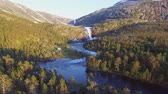 apressando : Aerial view of Rapid Stunning Waterfall in Husedalen Valley, Norway. Summer time. Stock Footage