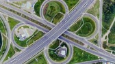 road top view : Static vertical top down aerial view of traffic on freeway interchange at night. timelapse background
