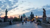 praga : Charles Bridge in Prague before the sunrise, Bohemia, Czech Republic. red sky Wideo