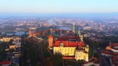 krakow : Krakow, Poland. Wawel royal Castle and Cathedral, Vistula River. Aerial 4K flyby video at sunrise in summer