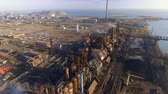 metallurgical industry : Aerial view over dirty smoke and smog from pipes of steel factory and blast furnaces. industrialized city, pollution from metallurgical plant. Ecological Stock Footage