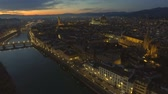 Aerial view of illuminated Florence, Italy at sunset. Cathedral Santa Maria