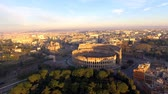 flavian : Flying over Colosseum, Rome, Italy. Aerial view of the Roman Coliseum on sunrise