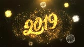 tebrik etmek : Happy New Year 2019 Greeting Card text Reveal from Golden Firework & Crackers on Glitter Shiny Magic Particles Sparks Night for Celebration, Wishes, Events, Message, holiday, festival Stok Video