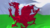 politiker : Wales-Flagge, die in der Wind-Zeitlupen-Animation wellenartig bewegt. 4K Realistische Stoff Textur Flagge Smooth Blowing an einem windigen Tag Continuous Seamless Loop Background.