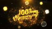 jubileu : 100th Happy Anniversary Text Greeting and Wishes card Made from Glitter Particles From Golden Firework display on Black Night Motion Background. for celebration, party, greeting card, invitation card.