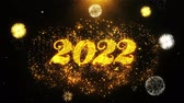 noel kartı : Happy New Year 2022 Text Sparks Particles Reveal from Golden Firework Display explosion 4K. Greeting card, Celebration, Party Invitation, calendar, Gift, Events, Message, Holiday, Wishes Festival Stok Video