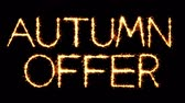 desconto : Autumn Offer Text Sparkler Writing With Glitter Sparks Particles Firework on Black 4K Loop Background. Greeting card, Invitation, Celebration, Party, Gift, Message, Wishes, Festival.