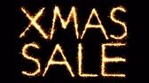 groothandel : Xmas Sale Text Sparkler Writing With Glitter Sparks Particles Firework on Black 4K Loop Background. Wenskaart, uitnodiging, feest, feest, cadeau, bericht, wensen, festival.