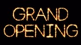 Grand Opening Text Sparkler Writing With Glitter Sparks Particles Firework on Black 4K Loop Background. Greeting card, Invitation, Celebration, Party, Gift, Message, Wishes, Festival. Dostupné videozáznamy