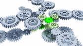 equipes : Silver Gears in Infinite Focused Rotation on Small Green Gear with a white background