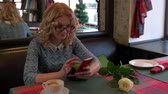 adult : girl in cafe working with the tablet Stock Footage