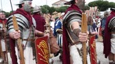 local de nascimento : ROME, ITALY - APRIL 19, 2015: Group of legionaries faithfully reconstructed by the Roman Historical Group, which makes a historical re-enactment with the occasion of the 2768th anniversary of Rome.