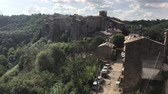balcony view : Calcata, the town of Viterbo, located at the north of Rome, overlooking the valley of Treja river. Stock Footage
