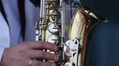 coat : men playing the saxophone close up Stock Footage