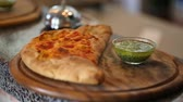 bell pepper ring : ready calzone with sauce on wooden plate