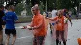 DNIPRO, UKRAINE- MAY 20: Volunteer giving washcloths with water on refreshment point at the 3rd INTERPIPE Dnipro Half Marathon 2018, May 20, 2018 in Dnipro, Ukraine