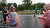 DNIPRO, UKRAINE- MAY 20: Volunteer giving water on refreshment point at the 3rd INTERPIPE Dnipro Half Marathon 2018, May 20, 2018 in Dnipro, Ukraine