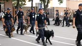 DNIPRO, UKRAINE- AUGUST 7, 2018: Police officers with service dogs are marching on parade for 3d national championship of canine national polices on August 7, 2018 in Dnipro, Ukraine