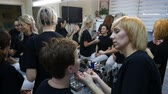 academia : DNIPRO, UKRAINE- DECEMBER 14, 2017: students training to become makeup artist at beauty studio on December 14, 2017 in Dnipro, Ukraine