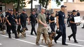 DNIPRO, UKRAINE- AUGUST 7, 2018: A k9 police officers with service dogs are marching on parade for 3d national championship of canine national polices on August 7, 2018 in Dnipro, Ukraine