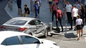 KYIV, UKRAINE-July 18, 2018: People near broken car at avenue after road accident and ignition, July 18, 2018 in Kyiv, Ukraine