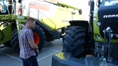 hozam : DNIPRO, UKRAINE - AUGUST 30, 2018: Combines, tractors and machinery during the agricultural exhibition, August 30, 2018 in Dnipro, Ukraine