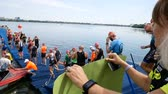 DNIPRO, UKRAINE-June 9, 2019: Dnipro Triathlon Festival, athletes are going to start for competition of swimming, June 9, 2019 in Dnipro, Ukraine Vídeos