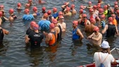 DNIPRO, UKRAINE-June 9, 2019: Dnipro Triathlon Festival, athletes are posing for photo before competition of swimming, June 9, 2019 in Dnipro, Ukraine Vídeos