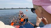 DNIPRO, UKRAINE-June 9, 2019: Dnipro Triathlon Festival, athletes in river before start of swimming competition, June 9, 2019 in Dnipro, Ukraine