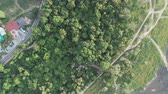 Aerial view of Lake along the forest along the road in countryside by drone. Landscape and nature theme. Asia traveling theme. Chonburi province in Thailand location