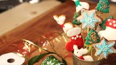 copy : Christmas gingerbread cookies on sticks. Decorated with ribbons.
