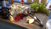 different kinds : Brie, camambert, gauda, grapes and currants on a wooden background. Stock Footage
