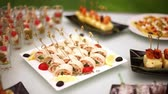banquette : Delicacies, appetizers, desserts at the Banquet. Buffet, catering service. On-site restaurant-5 Stock Footage