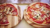 Homemade Pizza on a wooden trays.