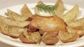 nutritious : Chicken thighs with potatoes on a plate