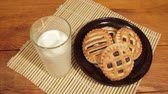 молочный : Man breakfast with milk and cookies on the wooden desk