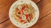 Pasta Penne with vegetable Sauce. Italian Cuisine. Pasta Dish. Prepared dish on wooden background 1920x1080 motion slow hd, 25 fps Stock Footage