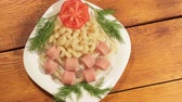 Pasta with sausages. Creative food art idea for children meal top view. Stock Footage