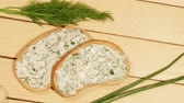 A sandwich with garlic sauce on wooden background