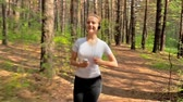 fitness : Jogging in park, young woman running in the park  Stock Footage