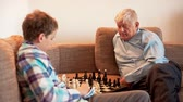 chess board : Move Forward, The Game of Chess, Teen and Grandpa Playing Chess Stock Footage