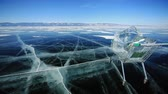 cartn corrugado : Shopping Cart With Ice Cubes The trolley rolls on the frozen surface of Lake Baikal