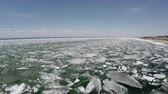 Spring break up on Lake Baikal, the movement of the ice, Shooting from a helicopter Stock Footage