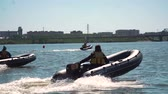 порыв : UFARUSSIA - 10.07.2017: Speed boat jet ski, floats with high speed in the water of lake. Стоковые видеозаписи