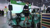 MOSCOW - RUSSIA, 20.03.2018: The girl uses a game simulator for 3d space. He walks in the virtual world