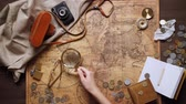 wood : old brass compass on wood table top view Stock Footage