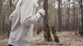 summer : Man running in forest woods training and look at smart watches.