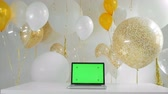 baloon : laptop with isolated green screen.Golden and silver balloons background. New Year concept. 1080p fullHD. Stock Footage