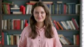 normal : portrait of lovely young librarian woman standing in library attractive student smiling close up